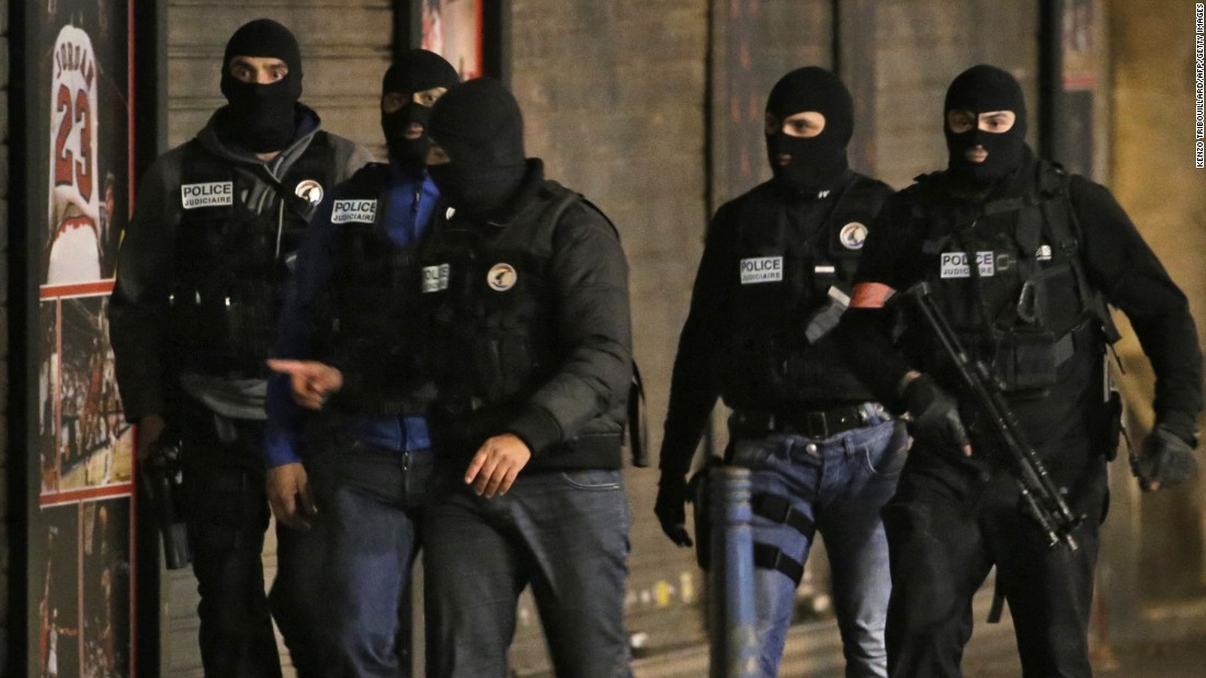 Members of the French police take up position.