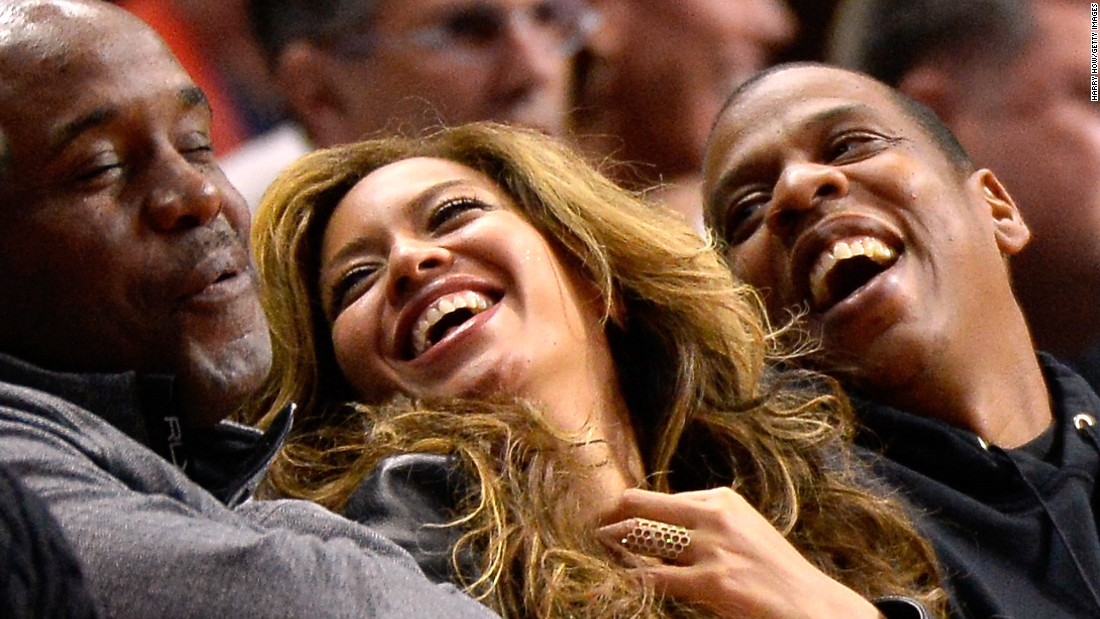Singer Beyonce and her husband, rapper Jay Z, laugh while sitting courtside at a Los Angeles Clippers basketball game on Thursday, January 22.