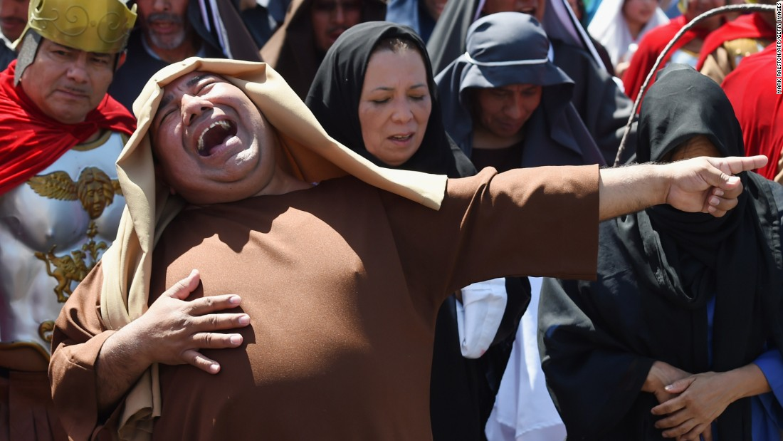 An actor laughs during a re-enactment of Jesus Christ's crucifixion Friday, April 3, in Los Angeles. The re-enactment was part of Good Friday festivities.