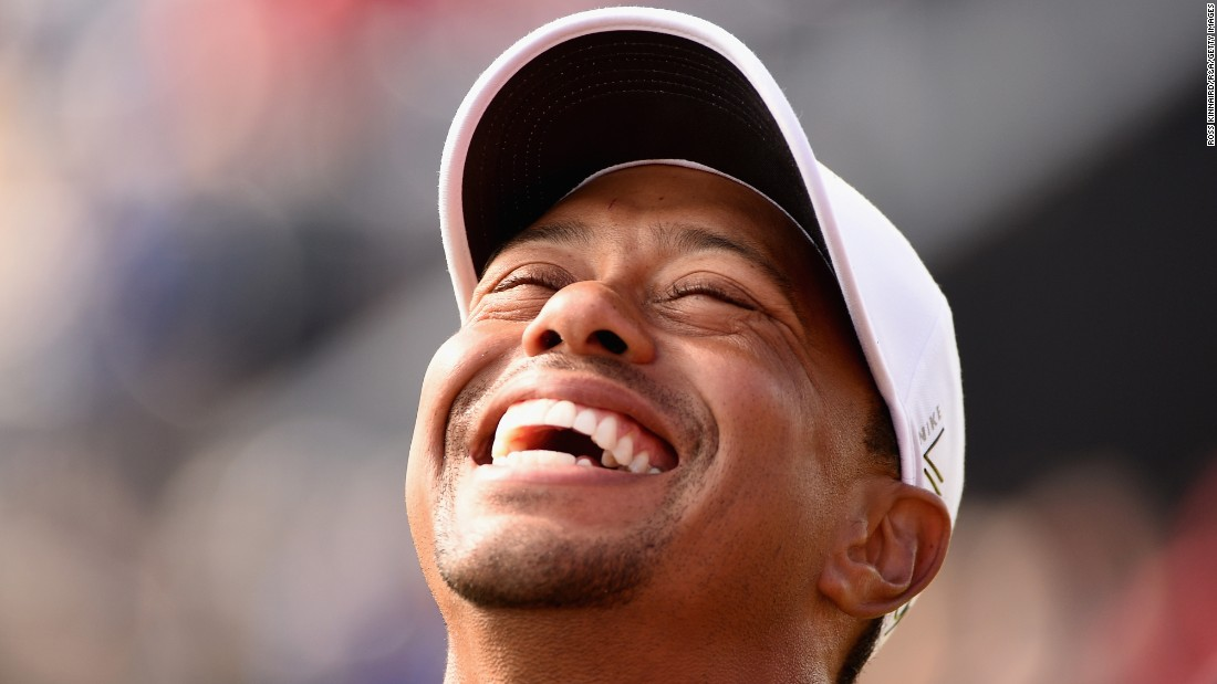 Tiger Woods laughs during the Champion Golfers' Challenge, a four-hole exhibition event held before the British Open on Wednesday, July 25.