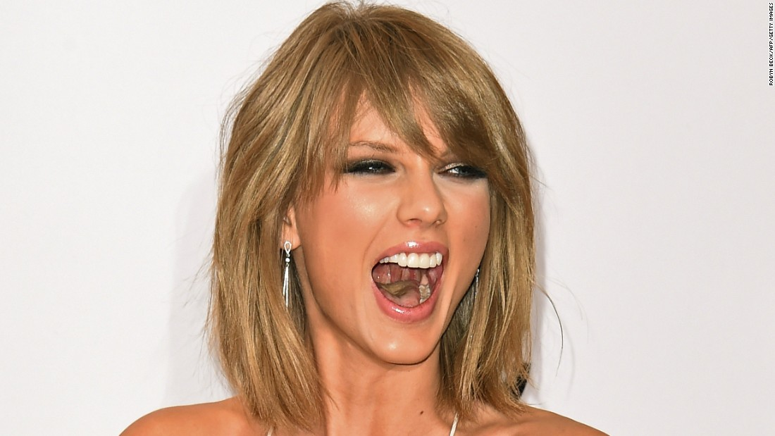 Pop star Taylor Swift laughs in the press room of the Billboard Music Awards on Sunday, May 17. She won eight awards, including top artist.