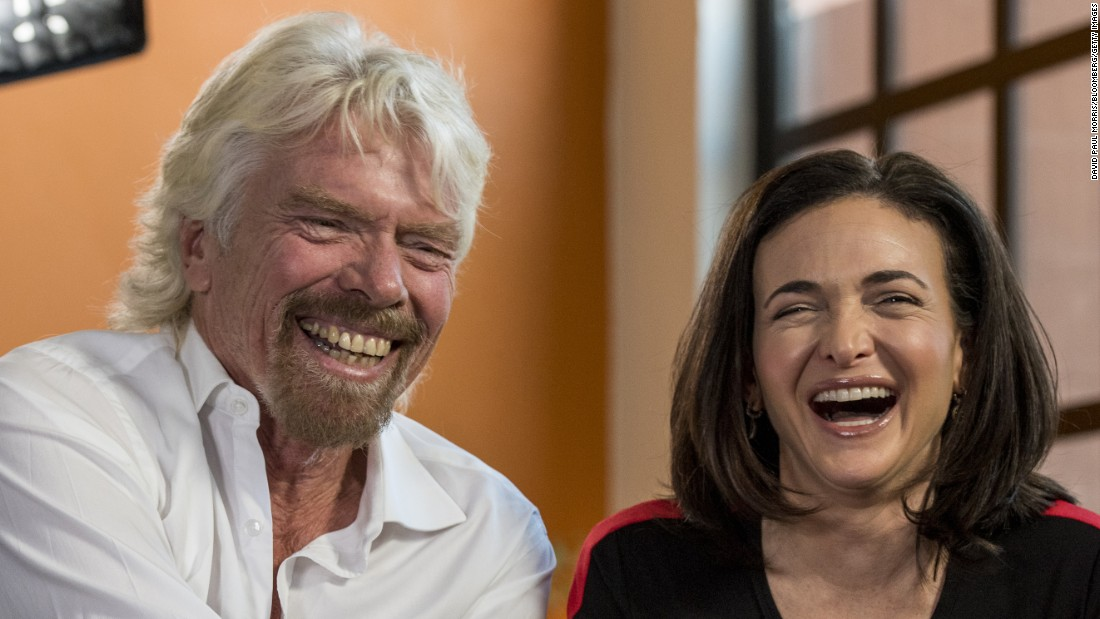 Virgin Group founder Richard Branson and Sheryl Sandberg, the chief operating officer of Facebook, have a laugh during a television interview in San Francisco on Thursday, April 23.