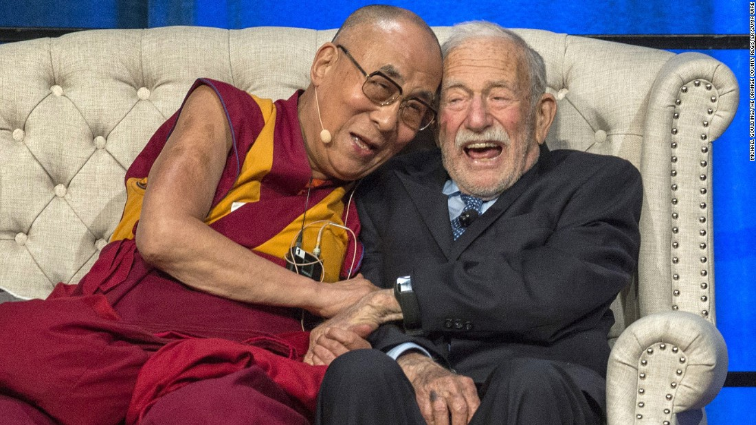 The Dalai Lama and oceanographer Walter Munk share a moment during a discussion about climate change Monday, July 6, at the University of California-Irvine.