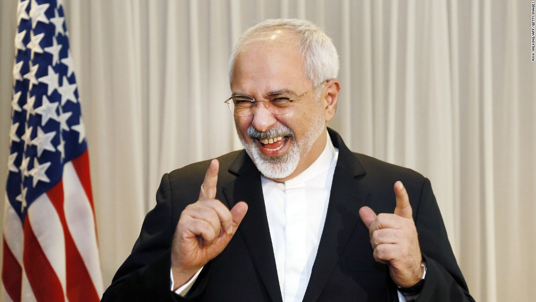 Iranian Foreign Minister Mohammad Javad Zarif jokes with reporters in Geneva, Switzerland, before meeting with U.S. Secretary of State John Kerry on Wednesday, January 14.