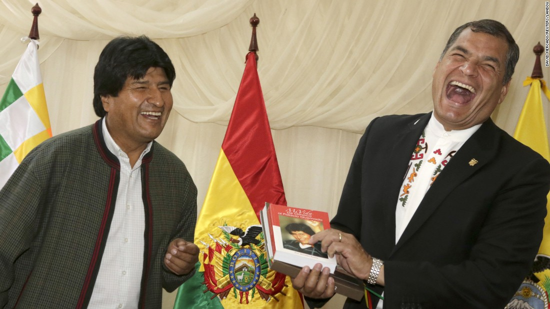 Ecuadorian President Rafael Correa, right, jokes with Bolivian President Evo Morales during a meeting in Tiquipaya, Bolivia, on Monday, October 12.