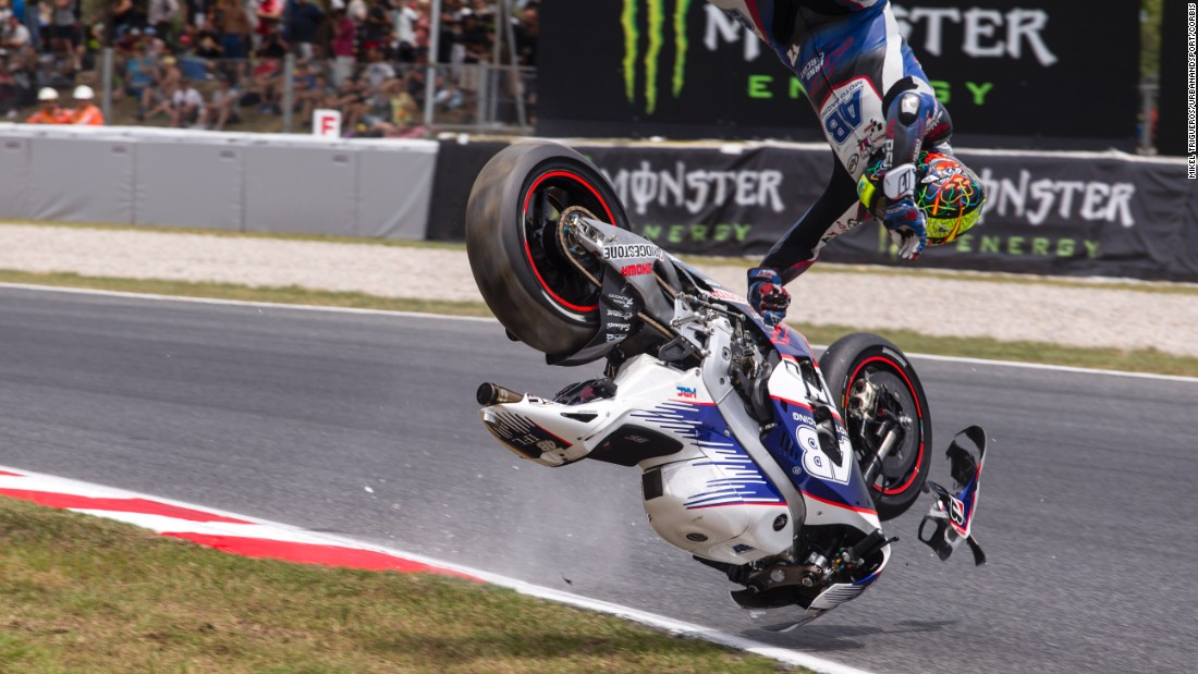 Czech motorcycle racer Karel Abraham crashes while practicing for the MotoGP event in Barcelona, Spain, on Saturday, June 13. His injuries kept him out of several races this season, but he eventually returned to competition.