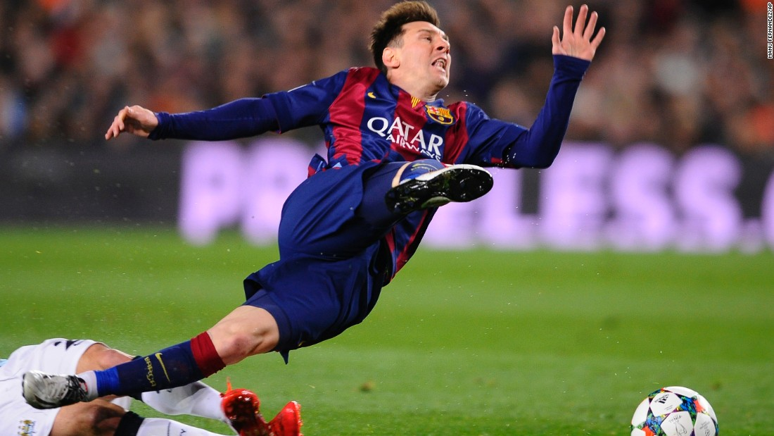 "Barcelona's Lionel Messi is tripped during a Champions League game against Manchester City on Wednesday, March 18. Barcelona won the match 2-1 and advanced to the quarterfinals of the European tournament, which it ended up winning in June. It was the Spanish club's <a href=""http://www.cnn.com/2015/06/06/football/champions-league-juventus-barcelona/"" target=""_blank"">fifth European title</a> and its first since 2011."