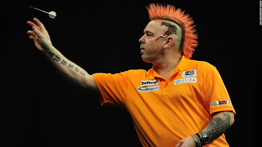 Colorful darts player Peter Wright competes in a Premier League Darts match Thursday, March 5, in Exeter, England.