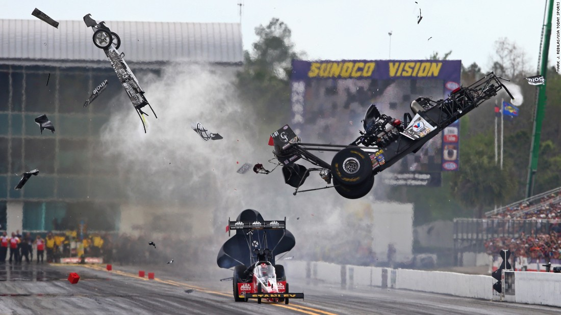 The car of drag racer Larry Dixon goes airborne during the Gatornationals event in Gainesville, Florida, on Saturday, March 14. The car broke in half, but Dixon walked away from the incident.