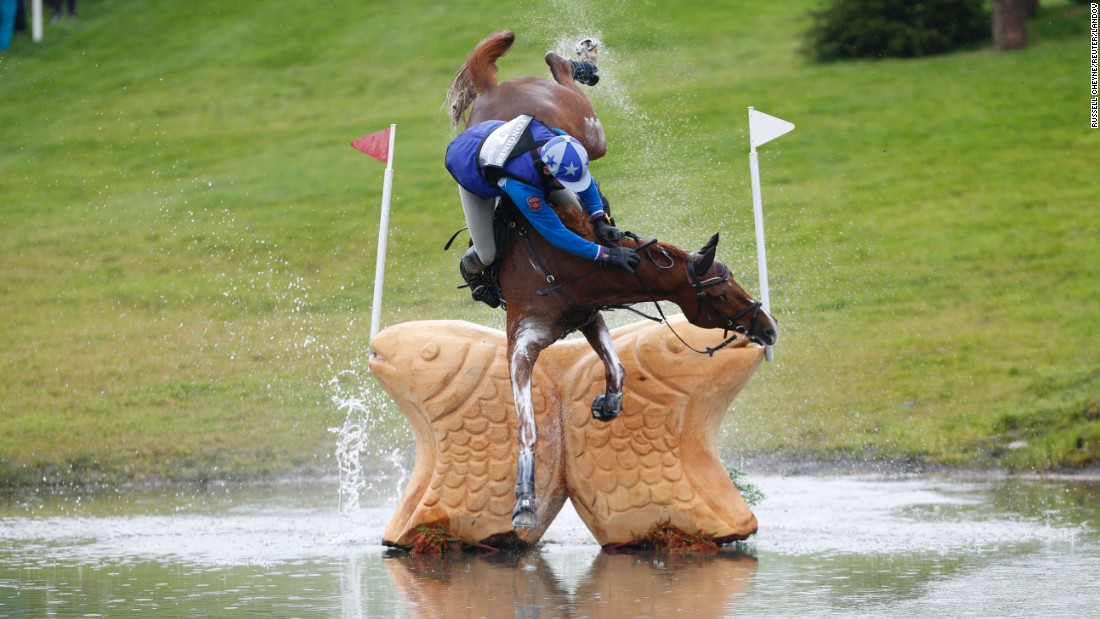 Mikhail Nastenko falls off his horse Reistag during an equestrian event in Blair Atholl, Scotland, on Saturday, September 12.