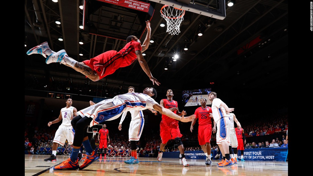 "Dayton's Kyle Davis leaps over Boise State's Chandler Hutchison during an NCAA Tournament game played Wednesday, March 18, in Dayton, Ohio. Dayton won 56-55 in what was a ""First Four"" matchup."