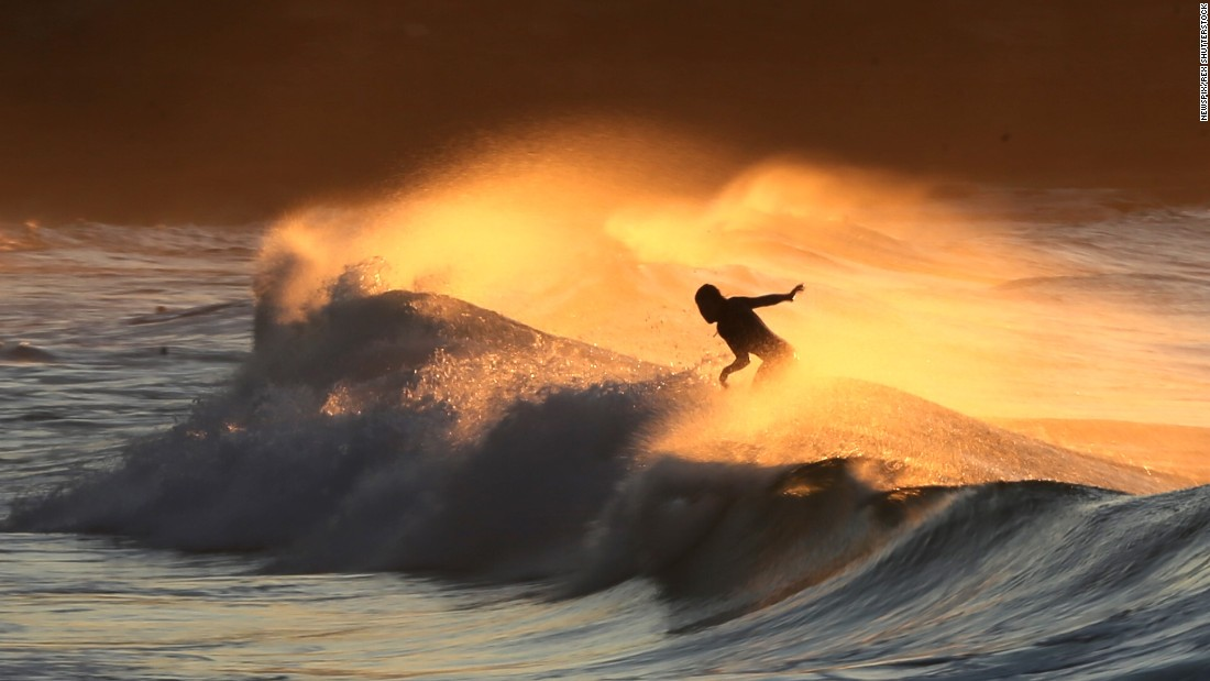 A surfer rides a wave in the Sydney suburb of Bronte on Thursday, August 6.