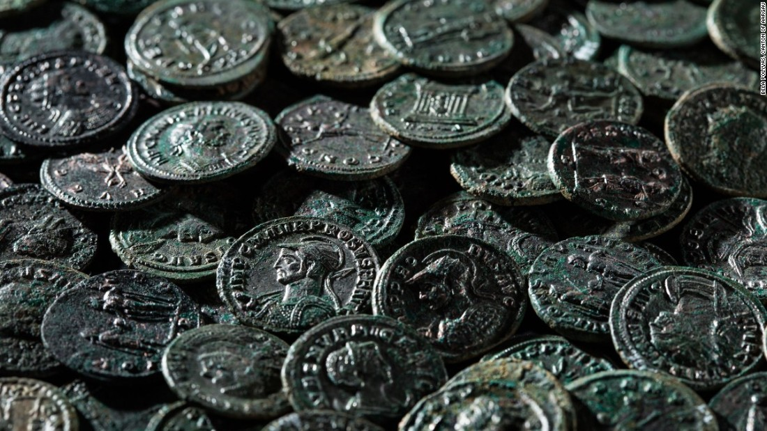 The coins, made of bronze and silver, were buried for 1,700 years, dating from the 3rd century.