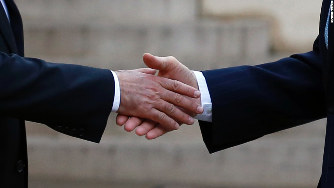 French President Francois Hollande, left, shakes hands with U.S. Secretary of State John Kerry after Kerry arrived at the Elysee Palace in Paris on Tuesday, November 17.