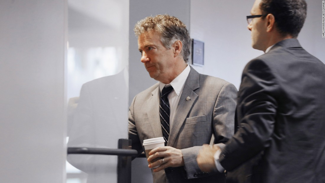 U.S. Sen. Rand Paul, left, arrives on Capitol Hill for a briefing about the Paris terrorist attacks and the American response on Wednesday, November 18.