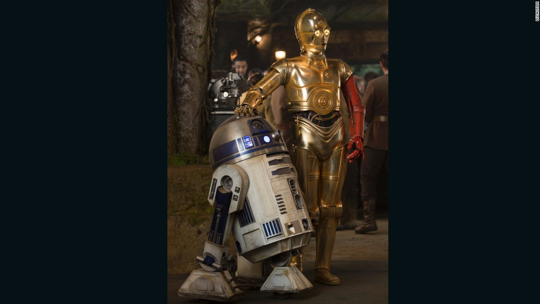 "Poor old Threepio looks like a third-hand car with a door of a different color. Sloppy repair work or outlandish style choice? Whatever the case, J.J. Abrams has <a href=""http://www.wired.com/2015/11/star-wars-force-awakens-jj-abrams-interview/"" target=""_blank"">confirmed</a> that the red arm comes from the desire to ""mark time,"" using a familiar character to signal the 30-year lapse since the end of ""Return of the Jedi."" We hear that the full story of C-3PO's limb replacement will be told in a <a href=""http://www.starwars.com/news/star-wars-special-c-3po-1"" target=""_blank"">comic book</a>.<br />"