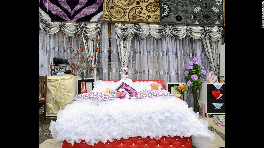 The dowry includes items curated throughout the bride's lifetime to place in the couple's new home. Blankets, dishes and other items are put on display outside the bride's home as a symbol of the family's worth.