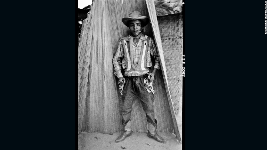Bill and photographer Jean Depara made Kinshasa his canvas in the 1950s, capturing cowboys like Andrada in the urban neighborhoods they staunchly defended. Depara was an erstwhile shoemaker until 1953, first taking up the camera at his wedding in 1950, when he bought a small  Adox camera to record the occasion. His lens would go on to detail myriad examples of pop culture in the bubbling metropolis, but his series on the Bills is among his most famous.