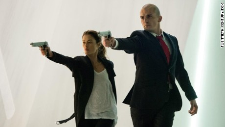 "Hannah Ware as Katia and Rupert Friend as the assassin star in ""Hitman: Agent 47."""