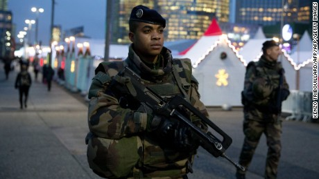 French soldiers patrol at Paris La Defense business district on November 24, 2015 as part of security measures set following November 13 Paris' terror attacks. AFP PHOTO / KENZO TRIBOUILLARD / AFP / KENZO TRIBOUILLARD        (Photo credit should read KENZO TRIBOUILLARD/AFP/Getty Images)
