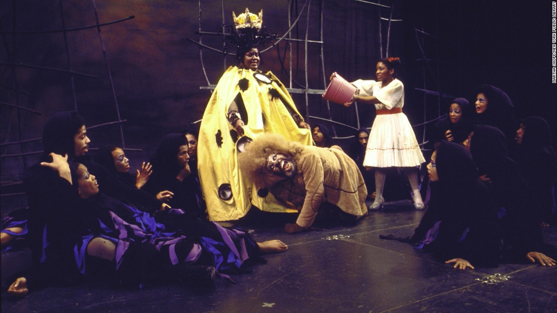 Mills throws water onto Mabel King playing Evillene, the Wicked Witch of the West. King and Ross also appeared in the film adaptation.