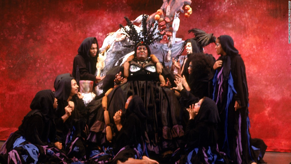King, surrounded by cast members, acts out a scene.