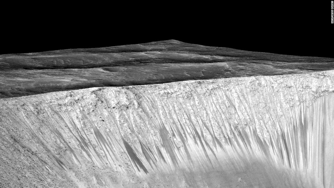 "<strong>September 28: </strong>NASA scientists announce that <a href=""http://www.cnn.com/2015/09/28/us/gallery/water-on-mars/index.html"" target=""_blank"">water still flows across the surface of Mars</a> from time to time. In the photo above, dark, narrow streaks called recurring slope lineae are seen on the slopes of the Gami Crater. Scientists have inferred that they were formed by contemporary flowing water."