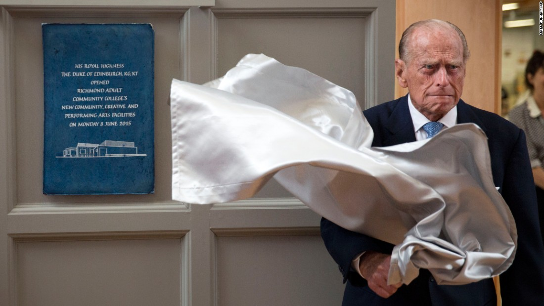 <strong>June 8:</strong> Britain's Prince Philip unveils a plaque at the end of his visit to Richmond Adult Community College, a school in southwest London that was opening its new art, drama and dance facilities.