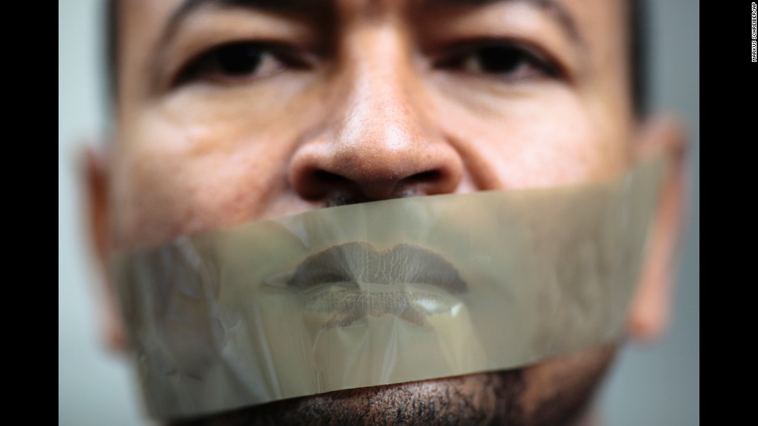 <strong>June 22:</strong> A man with tape over his mouth attends a demonstration in Berlin. The demonstration was held to support Ahmed Mansour, a senior journalist with Al Jazeera who was detained in Germany at the request of the Egyptian government. He was later released.