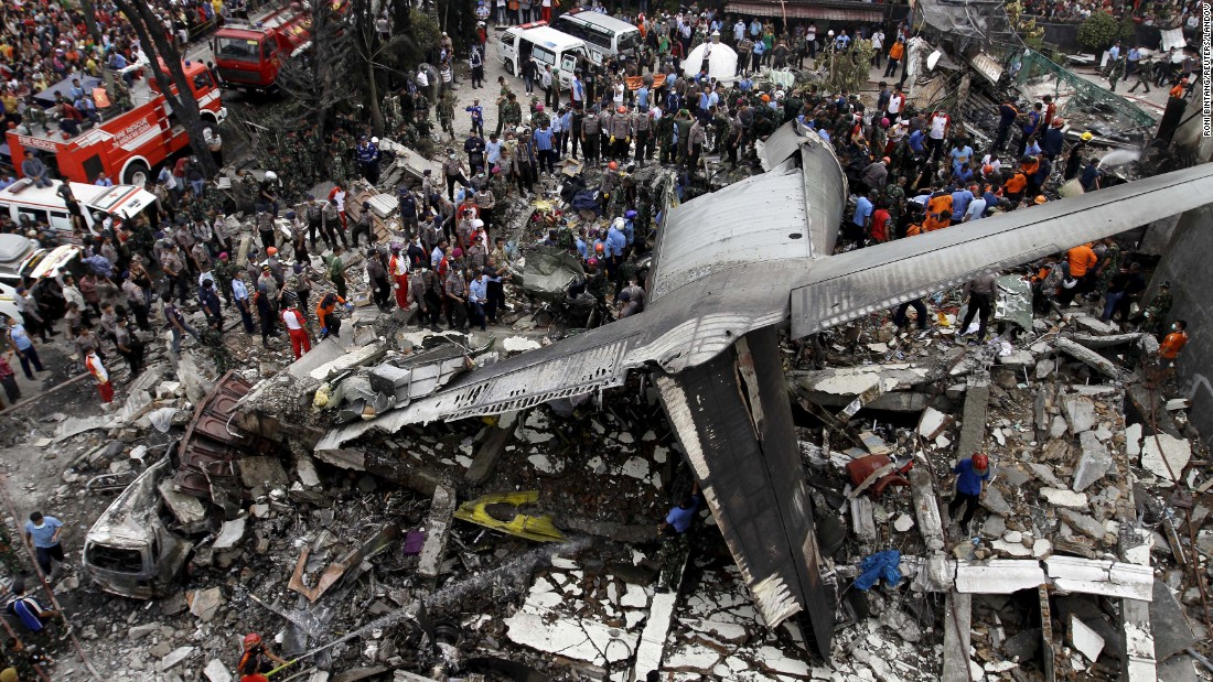"<strong>June 30:</strong> Security forces and rescue teams examine the wreckage of a military transport plane after it <a href=""http://www.cnn.com/2015/06/30/world/gallery/indonesia-plane-crash/index.html"" target=""_blank"">crashed into a residential area</a> in Medan, Indonesia. At least 135 people were killed. The plane was carrying military personnel and their family members, as well as students and other civilians."