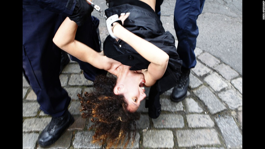 "<strong>February 10:</strong> An activist from the Ukrainian feminist group Femen is arrested by police in Lille, France, after protesting in front of the convoy of Dominique Strauss-Kahn. Strauss-Kahn, the former chief of the International Monetary Fund, was on trial for aggravated pimping charges. <a href=""http://www.cnn.com/2015/06/12/europe/france-strauss-kahn-verdict/"" target=""_blank"">He was acquitted</a> in June."