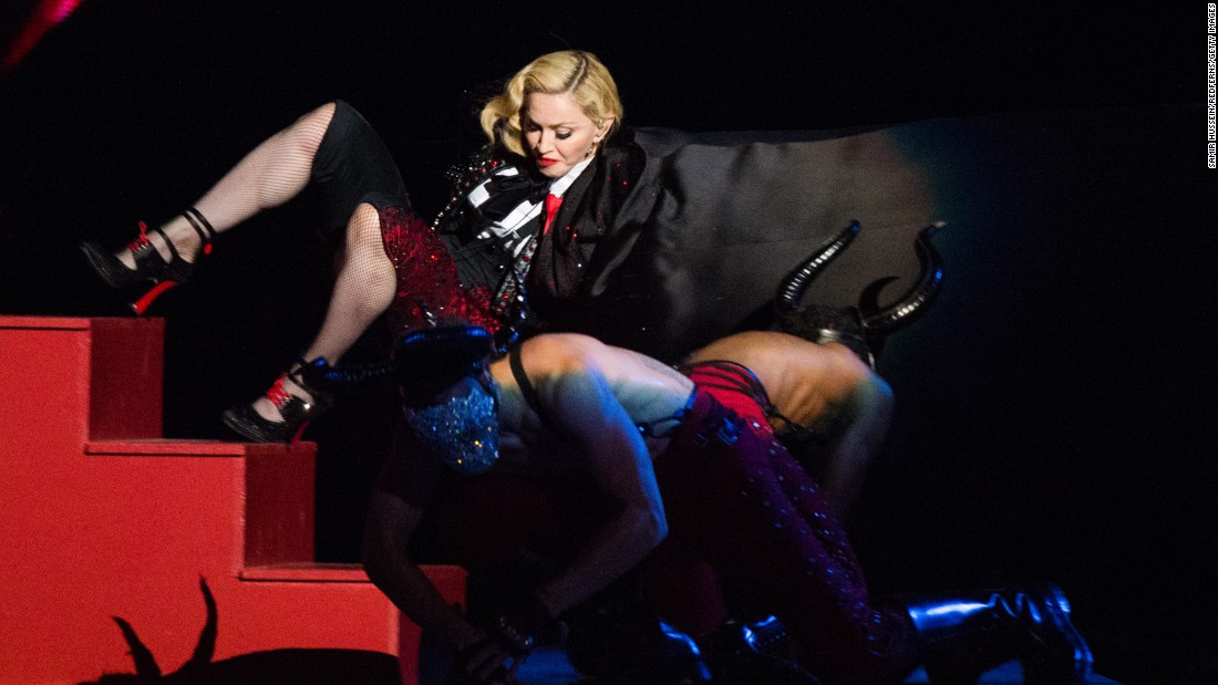 "<strong>February 25:</strong> Singer Madonna falls as she performs ""Living for Love"" at the Brit Awards in London."