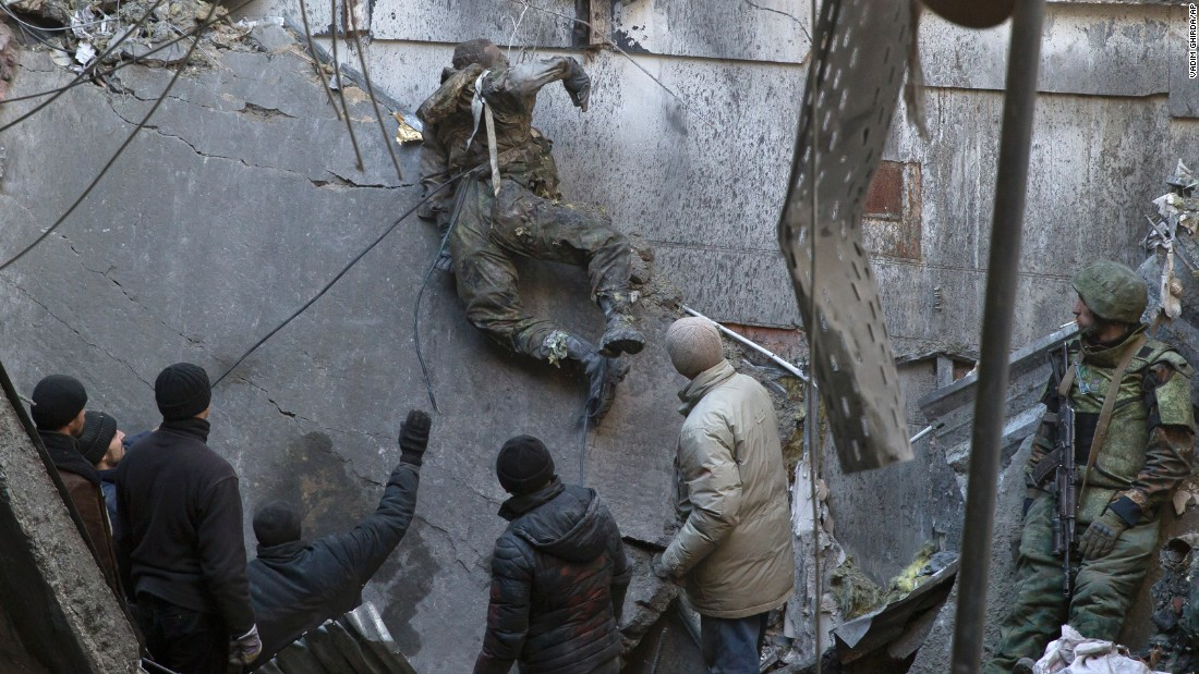 <strong>February 25:</strong> The body of a Ukrainian serviceman is removed from rubble after a battle over the airport in Donetsk, Ukraine.