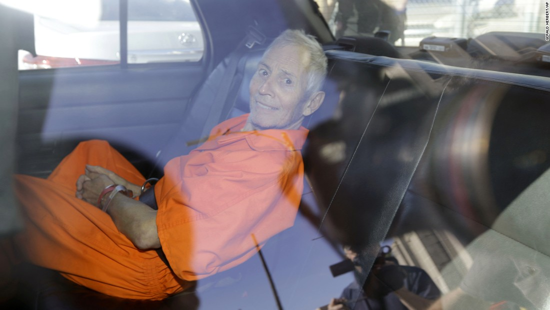 "<strong>March 17:</strong> <a href=""http://www.cnn.com/2015/03/16/us/gallery/robert-durst/index.html"" target=""_blank"">Robert Durst,</a> a wealthy New York real-estate heir, is transported to Orleans Parish Prison after his arraignment in New Orleans. Durst faces felony firearm and drug charges in New Orleans, and he has been charged with first-degree murder in Los Angeles. Investigators say they believe Durst was behind the slaying of Susan Berman, his longtime friend. Durst is also the focus of the HBO documentary series ""The Jinx,"" which explores his wife's 1982 disappearance and investigators' suspicions that Berman was killed because she knew what happened to her. Durst has long maintained he didn't kill Berman or have anything to do with his wife's disappearance."