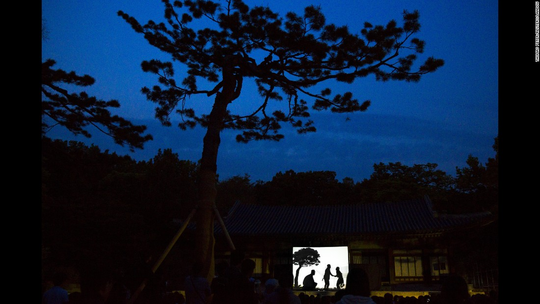 <strong>May 6:</strong> People watch a shadow play performance at Changgyeonggung Palace in Seoul, South Korea.