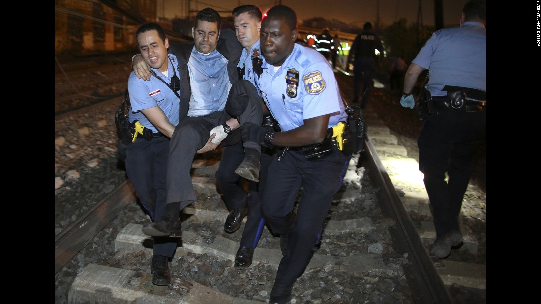 "<strong>May 12:</strong> Emergency personnel help a passenger at the scene of an Amtrak crash in Philadelphia. At least eight people were killed and more than 200 were injured when <a href=""http://www.cnn.com/2015/05/13/homepage2/gallery/philadelphia-amtrak-crash/index.html"" target=""_blank"">the train derailed</a> on its way from Washington to New York."