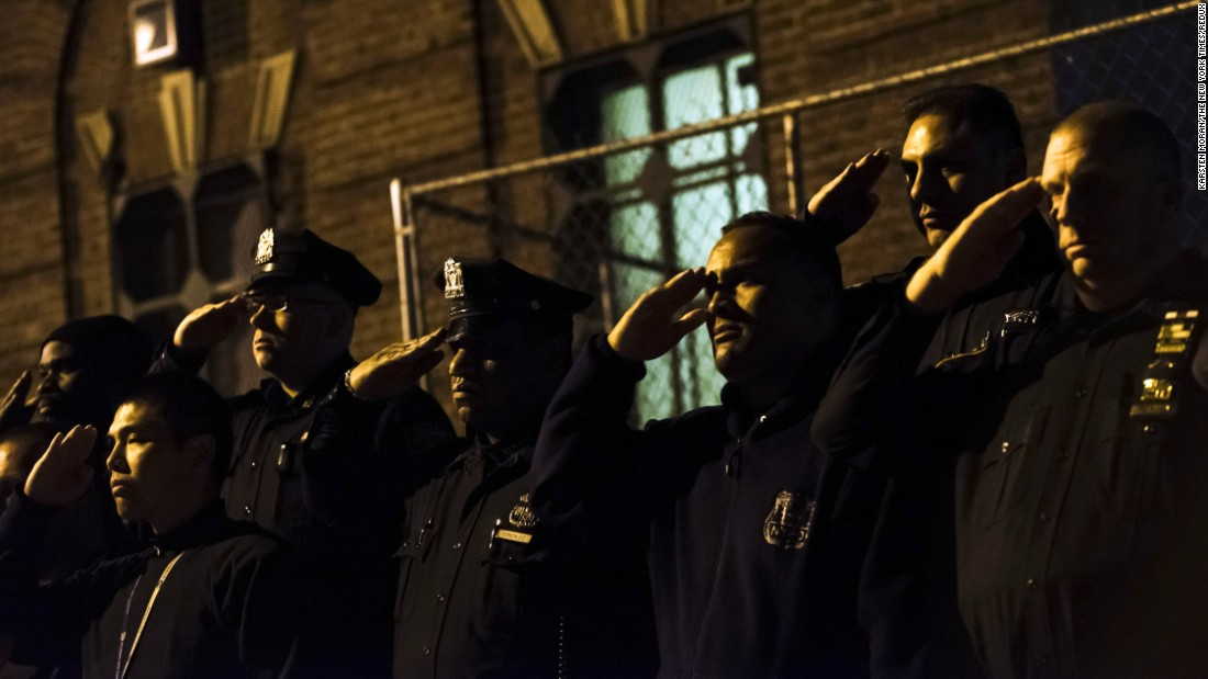 "<strong>October 21:</strong> New York City police officers salute as the body of Officer Randolph Holder, 33, is taken away in an ambulance. <a href=""http://www.cnn.com/2015/10/21/us/new-york-police-officer-killed/"" target=""_blank"">Holder had been fatally shot</a> in the line of duty."