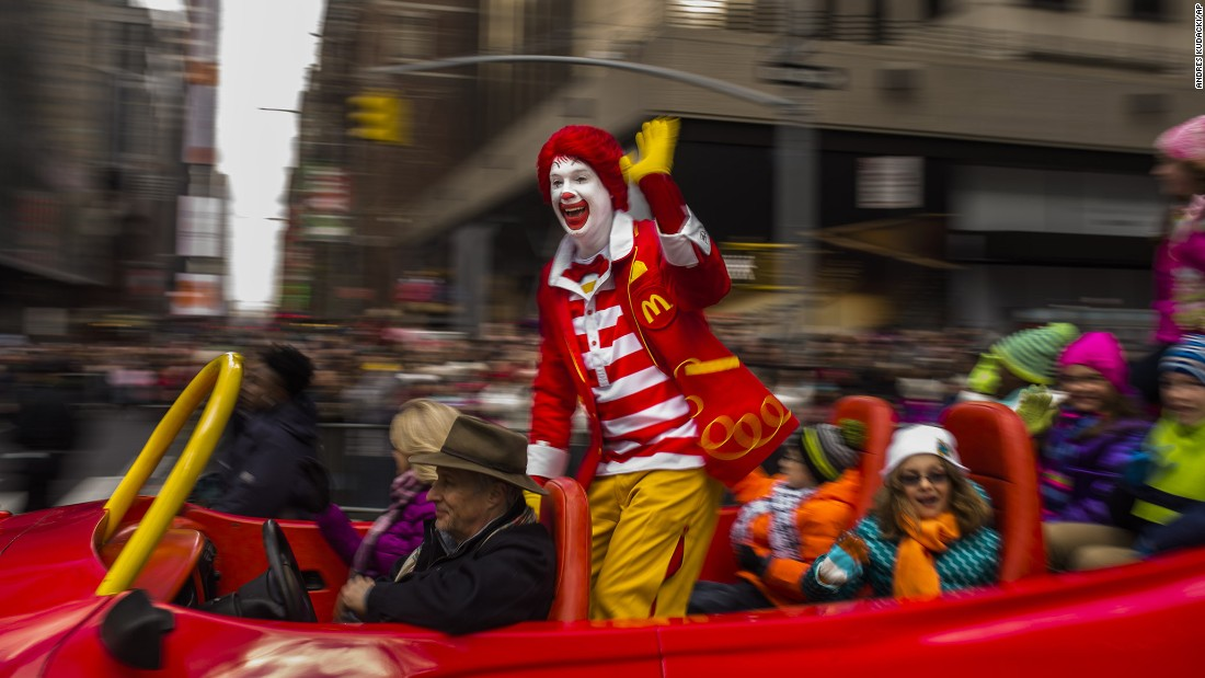 Ronald McDonald waves to the crowd during the parade.