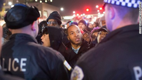 Demonstrators confront police during a protest in November 2015 over Laquan McDonald's death.