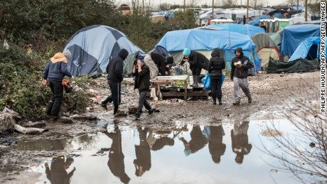 "Migrants and refugees live in squalid conditions in the migrant camp known as ""The Jungle."""