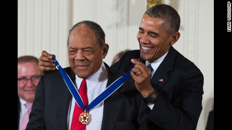 "Baseball Hall of Famer Willie Mays, left, receives the Presidential Medal of Freedom from President Barack Obama during a ceremony in the East Room of the White House, on Tuesday, Nov. 24, 2015, in Washington. Obama is recognizing 17 people with the nation's highest civilian award, including one of the greatest catchers in baseball history and a ""Funny Girl."" (AP Photo/Evan Vucci)"