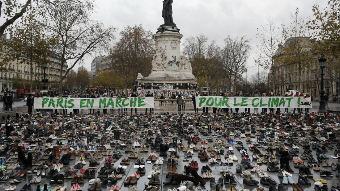 Hundreds of pairs of shoes are displayed at the Place de la République.