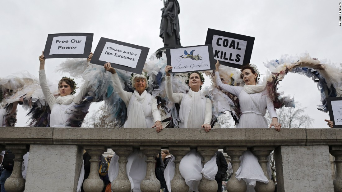 Women dressed as angels pose at the Place de la République.