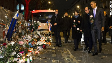 President Barack Obama, French President Francois Hollande, second from right, and Paris Mayor Anne Hidalgo arrive at the Bataclan, site of one of the Paris terrorists attacks, to pay their respects to the victims on Monday  in Paris. (AP Photo/Evan Vucci)