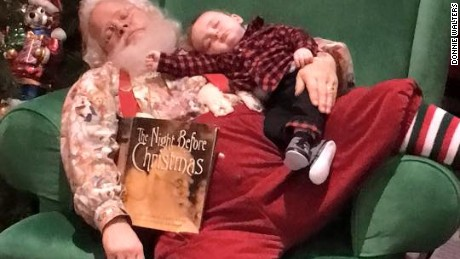 Baby Zeke Walters falls asleep waiting for Santa