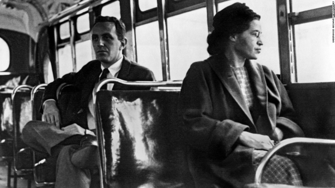 "Rosa Parks <a href=""http://www.cnn.com/2010/US/12/01/rosa.parks.anniversary/index.html"">became one of the major symbols of the civil rights movement</a> after she was arrested in Montgomery, Alabama, for refusing to give up her seat to a white passenger in 1955. For 381 days, African-Americans boycotted public transportation to protest Parks' arrest and, in turn, segregation laws. The boycott led to a Supreme Court ruling desegregating public transportation in Montgomery. In this photo, Parks rides the bus a day after the Supreme Court ruling in 1956."