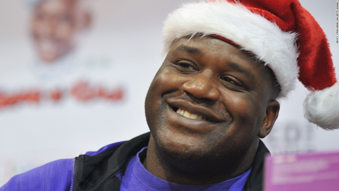 "You could<a href=""https://www.omaze.com/experiences/red-shaq"" target=""_blank""> join a holiday-themed photo shoot with Shaquille O'Neal</a> and grab a meal with the hoops legend. Use the pictures for your personal ""Us & Shaq"" holiday card."