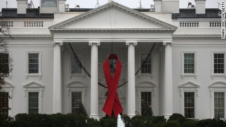 A red ribbon is displayed on the North Portico of the White House to recognize World AIDS Day on December 1, 2015 in Washington.