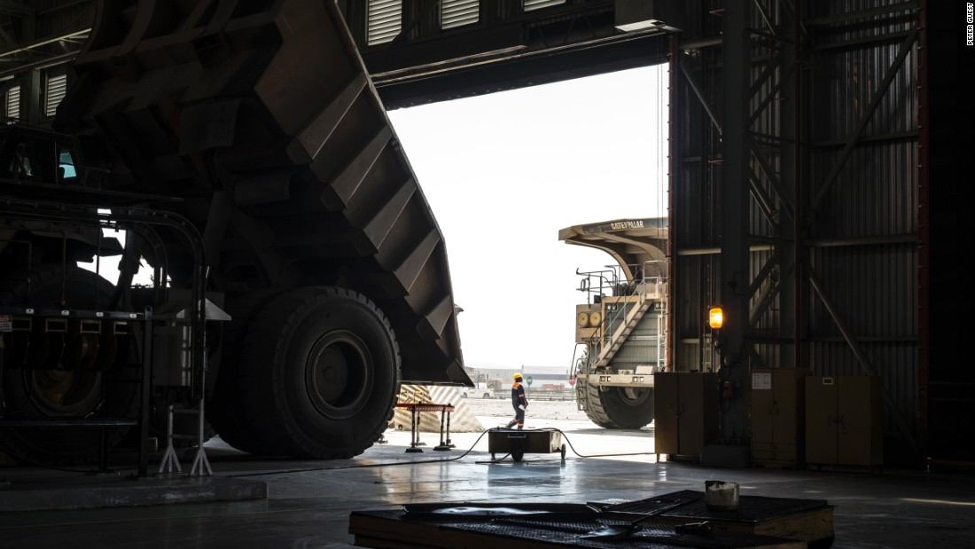 A worker inspects a 300-tonne truck at the Jwaneng diamond mine in Botswana, November 2015