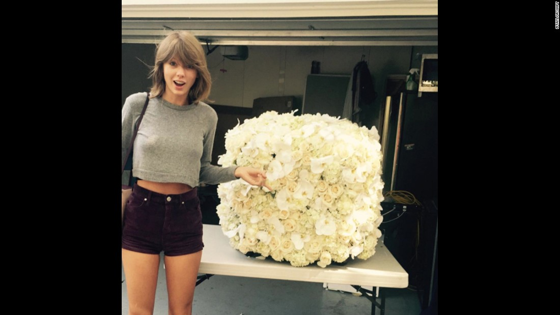 "Taylor Swift's photo of her <a href=""https://www.instagram.com/p/7OZIdGDvFT/"" target=""_blank"">posed next to flowers</a> sent by Kanye West ranks as the second most-liked photo on Instagram. It got 2.6 million likes in 2015."